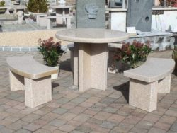 BEIGE GRANITE ROUND TABLE AND 3 BENCHES